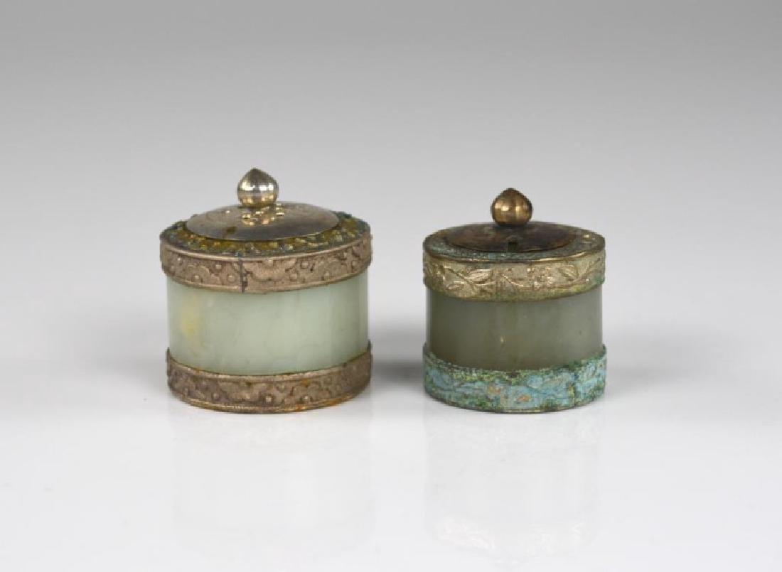 TWO JADE ARCHER RINGS MOUNTED AS SALT CELLARS