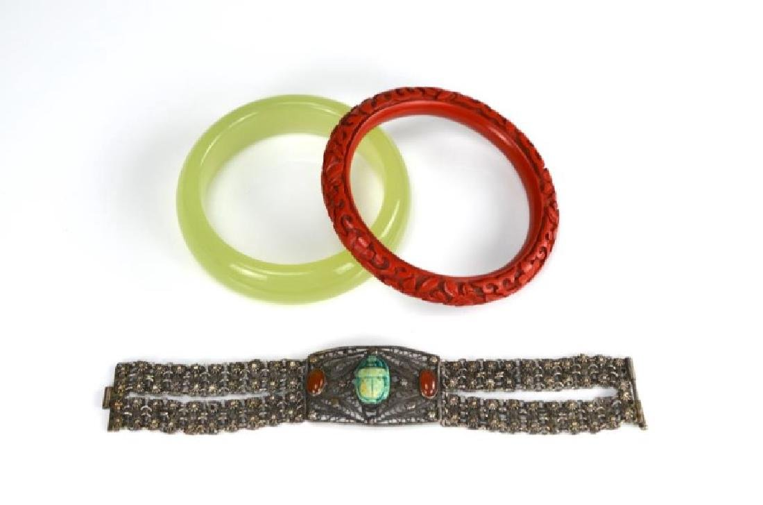 Two Asian bangles and a filigree bracelet