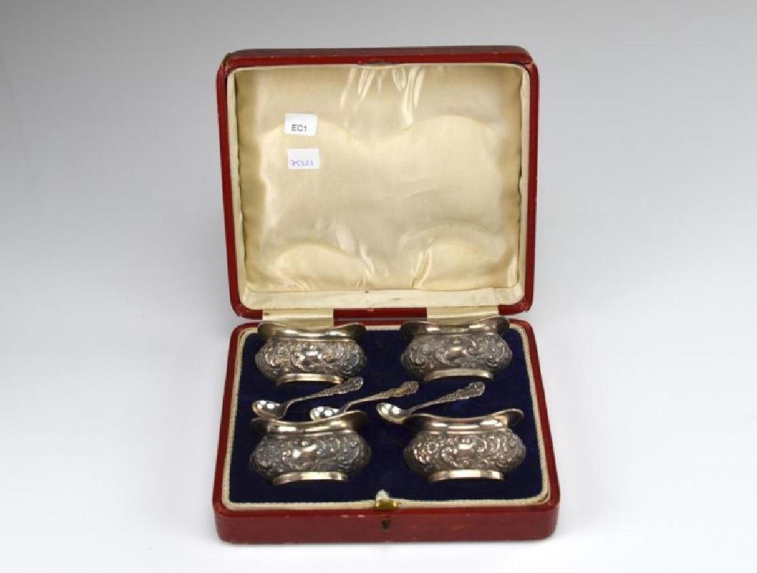 Four Edwardian silver salts with three spoons