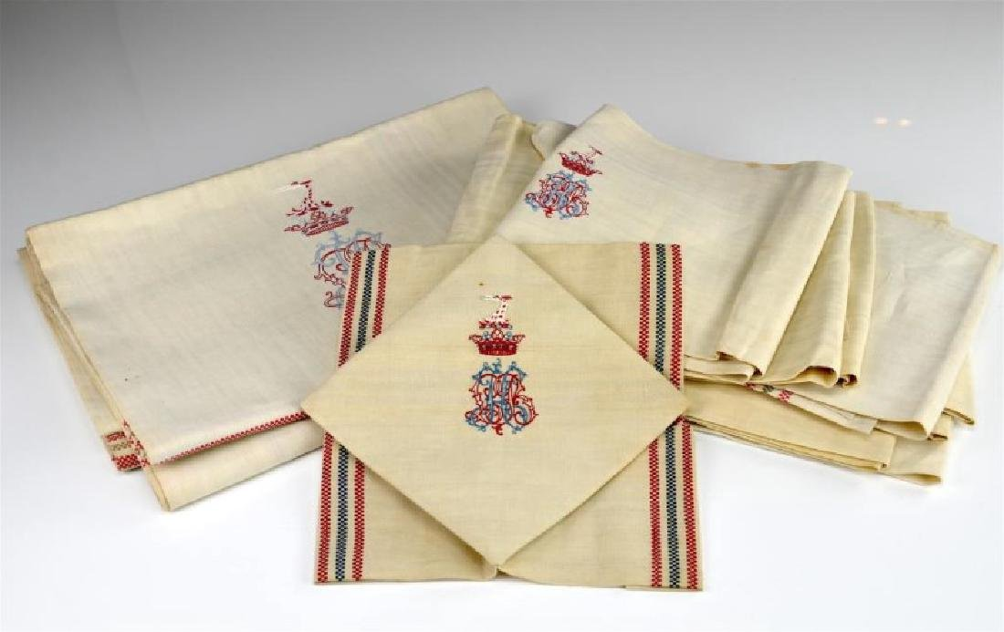 Eleven monogrammed and crested linens