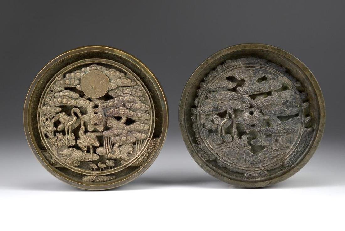 TWO JAPANESE BRONZE AND TIN HAND MIRRORS