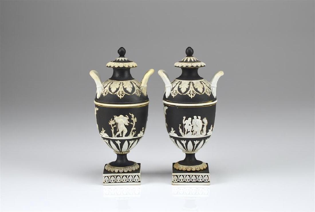 Two Wedgwood black basalt Jasperware covered vases