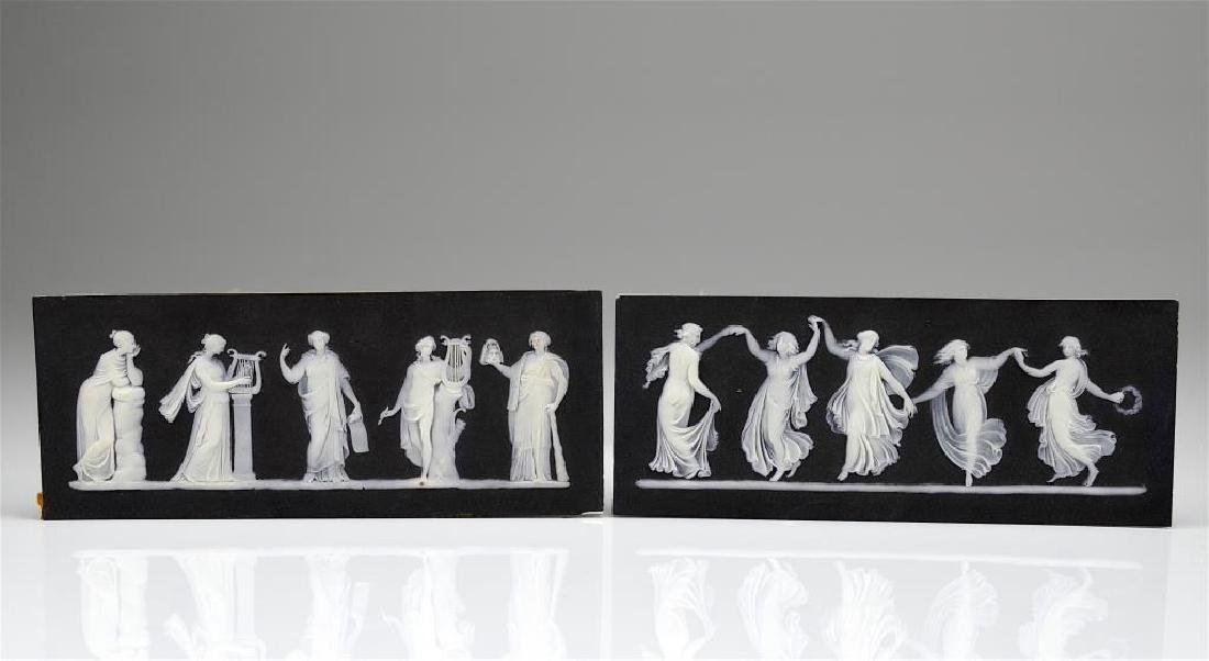 Two Wedgwood black basalt Jasperware plaques