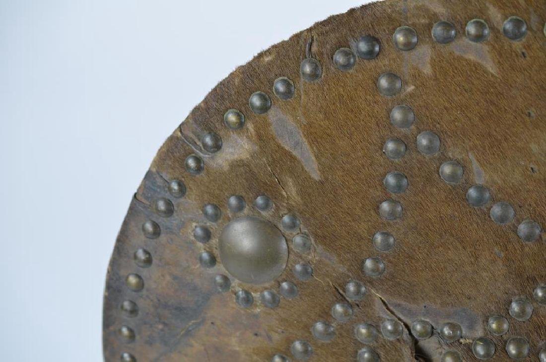 Early hide covered studded shield - 3