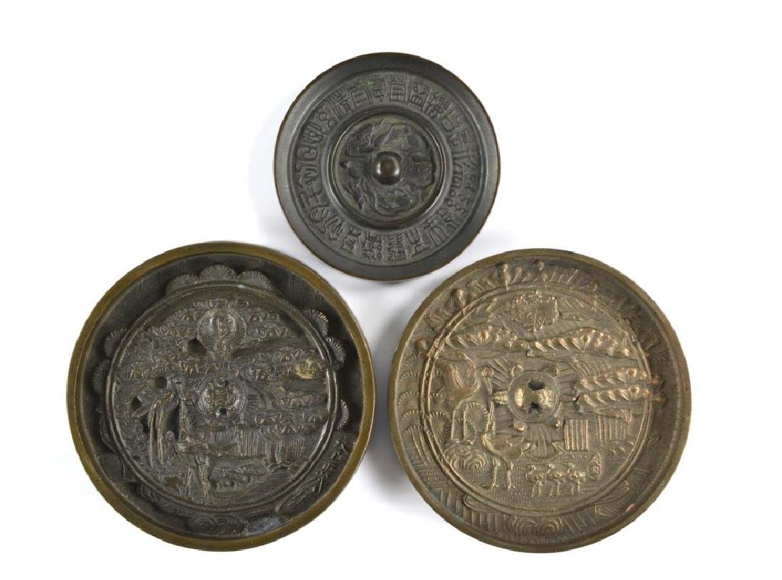 THREE CHINESE AND JAPANESE BRONZE HAND MIRRORS