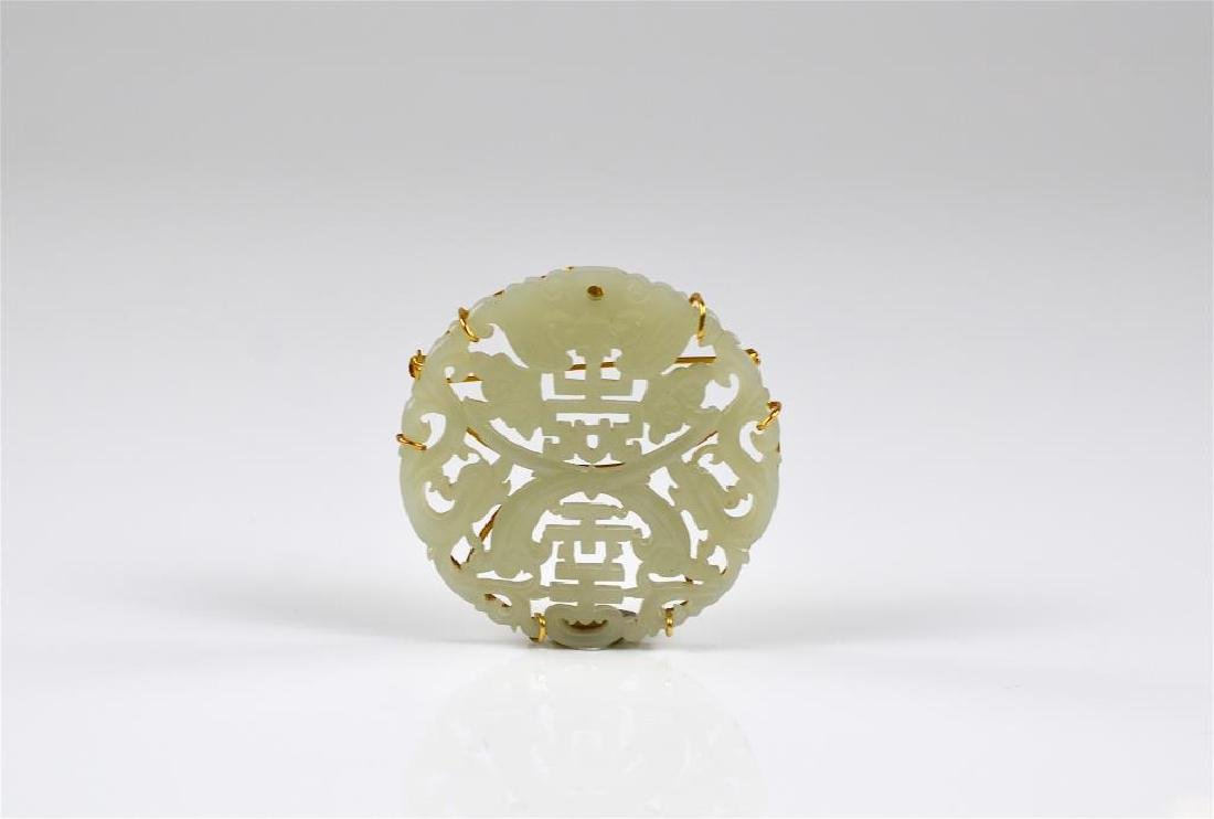 JADEITE PLAQUE MOUNTED IN GOLD