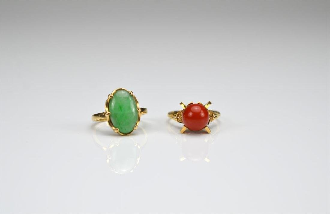 Two gold rings set with jadeite and coral