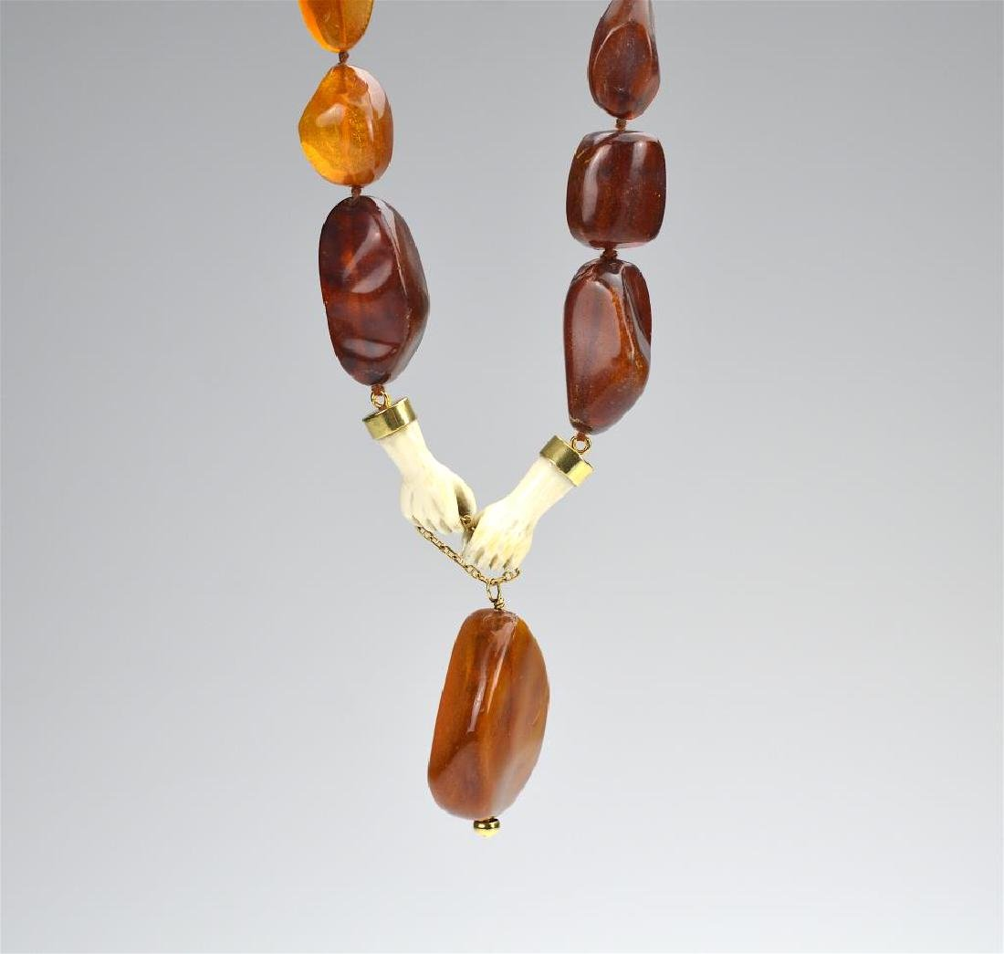 Amber and ivory necklace