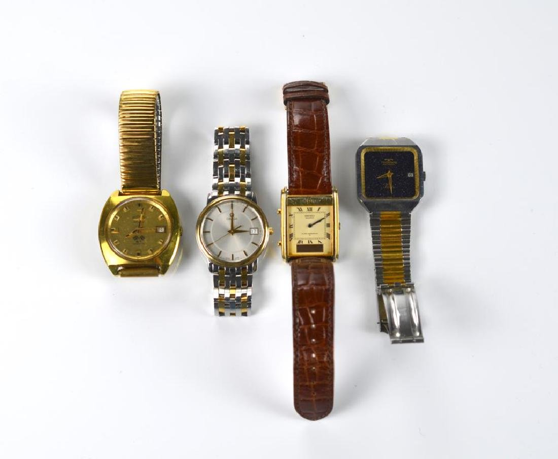 Four men's wristwatches