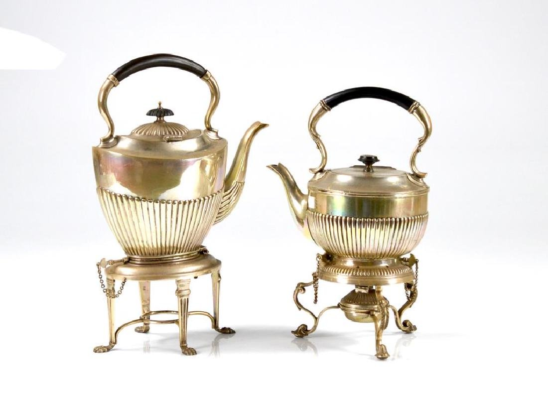 Two silver plate kettles on stands