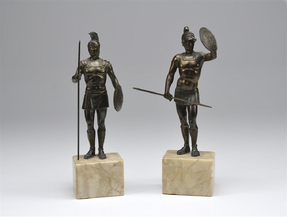Two bronze sculptures of Roman soldiers