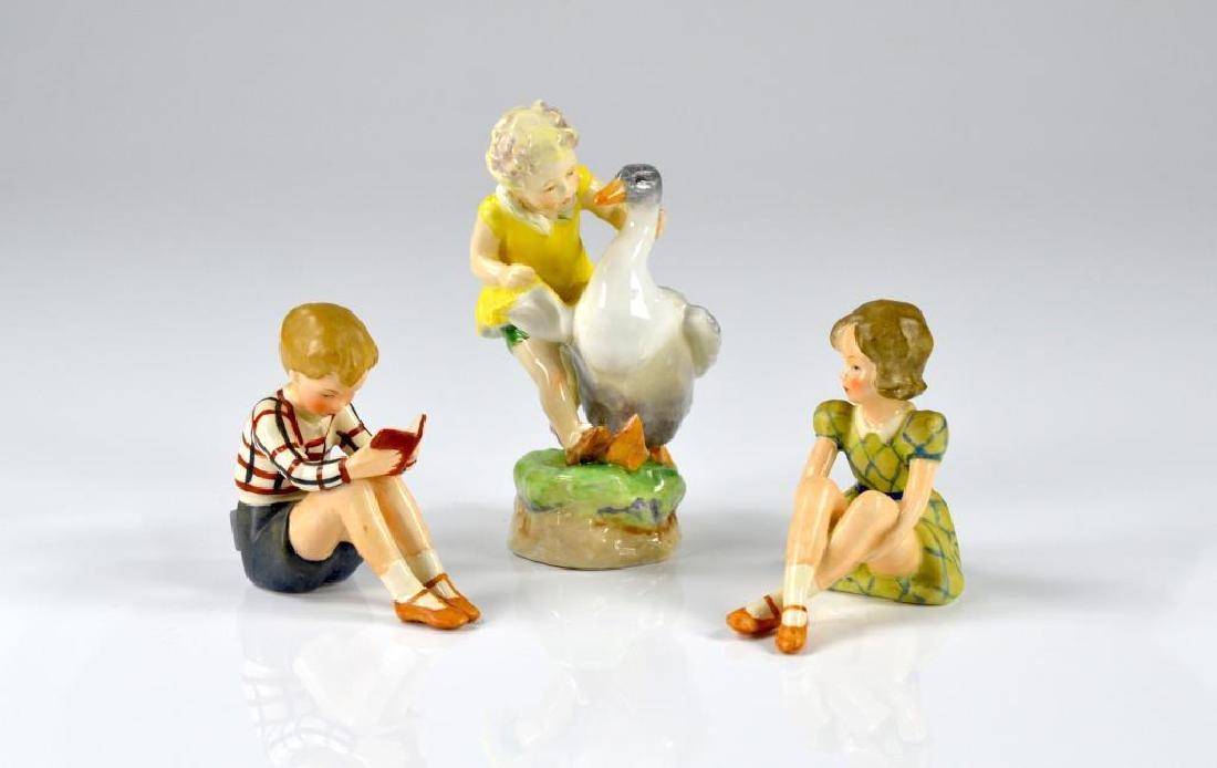 Royal Worcester figure w/ two Goebel figures
