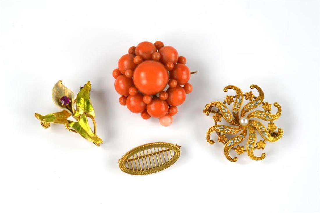 Three gold pins and a coral brooch pin