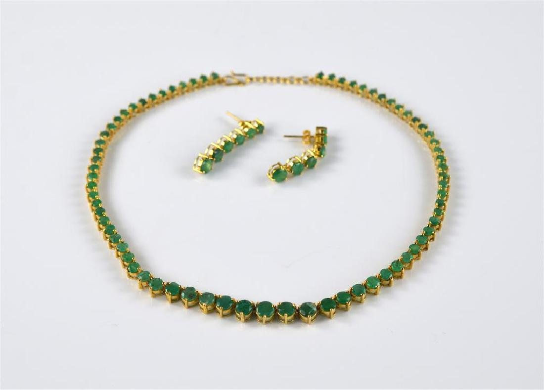 Gold and emerald necklace and earrings set
