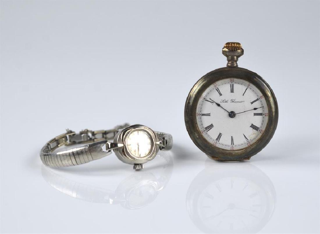 Seth Thomas pocket watch & a gold ladies watch