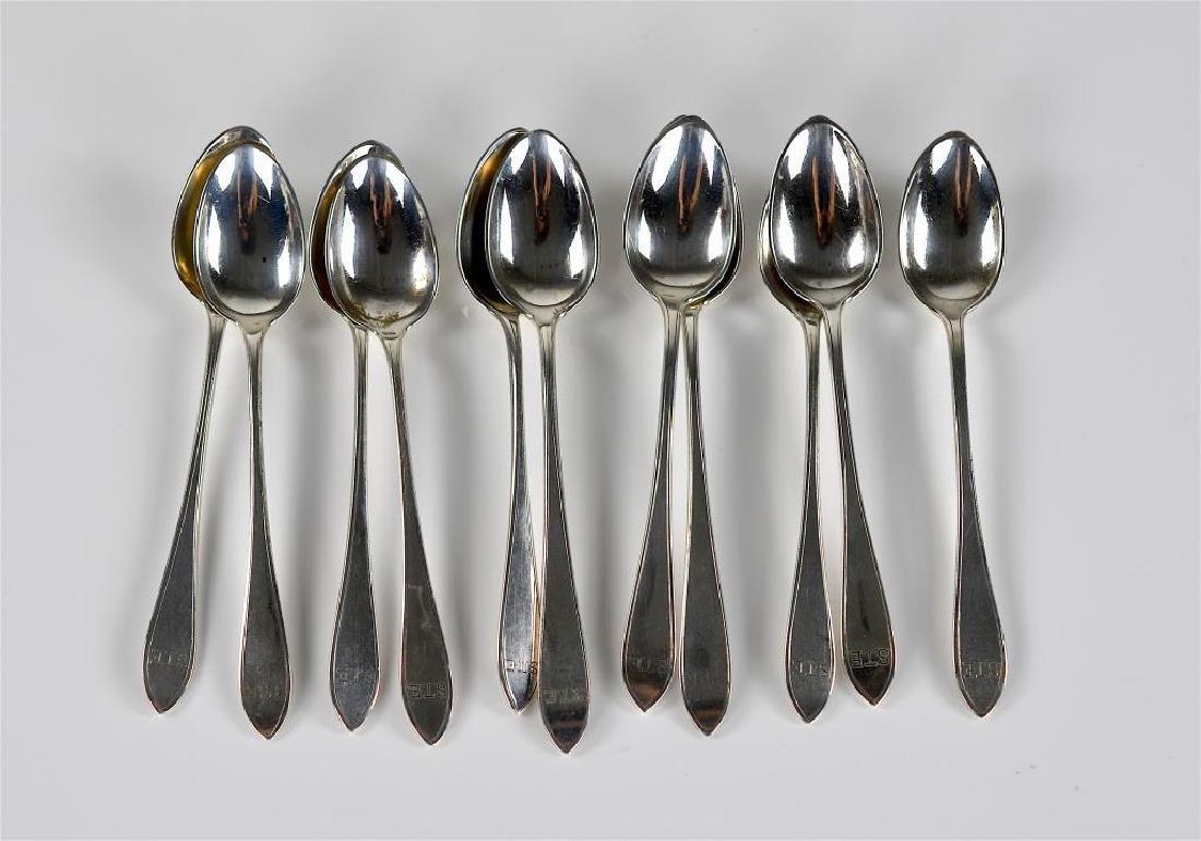 Twelve Arthur Stone silver teaspoons