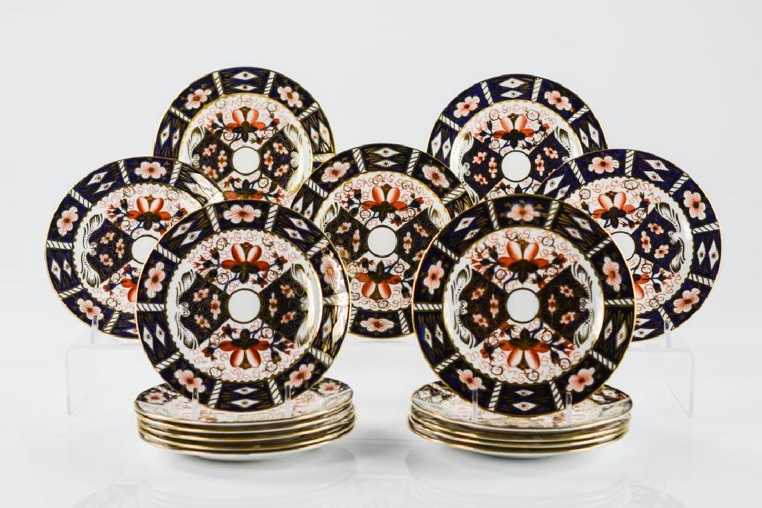 Sixteen Royal Crown Derby bread and butter plates