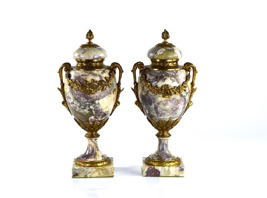 Pair of marble & bronze covered urns
