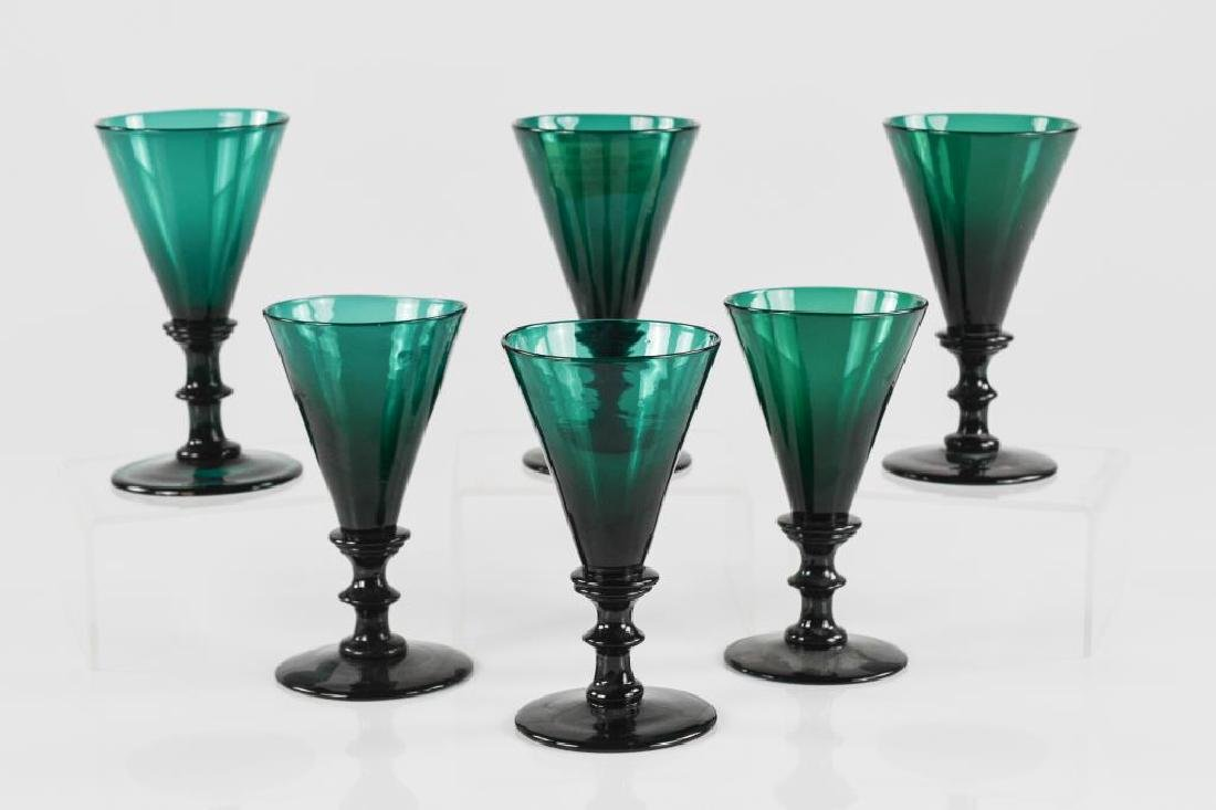 Six Georgian emerald green baluster wine glasses
