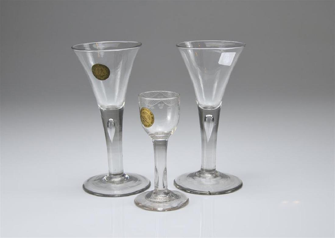 Pair of Georgian wine glasses w/ another