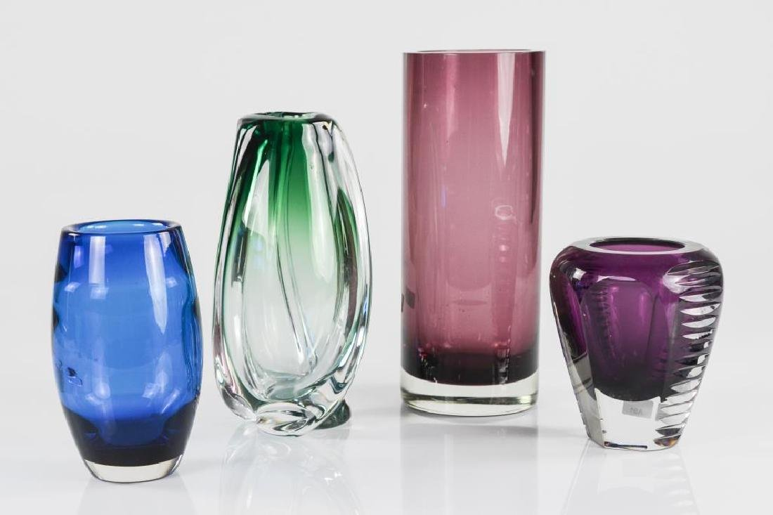 Four vintage coloured glass vases
