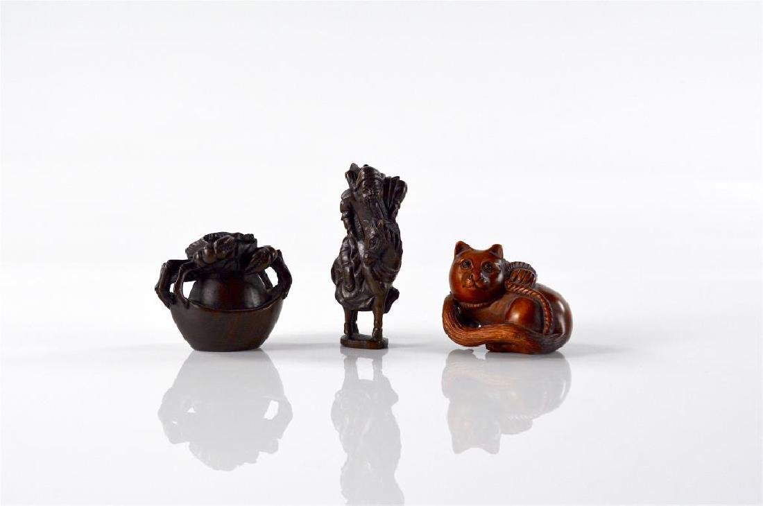 THREE JAPANESE WOOD CARVED NETSUKES