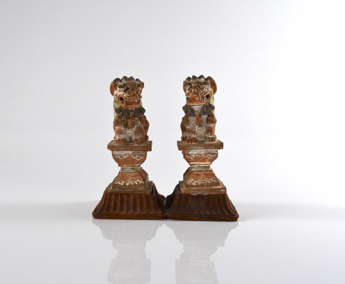 PAIR OF CHINESE POLYCHROME POTTERY GUARDIAN LIONS