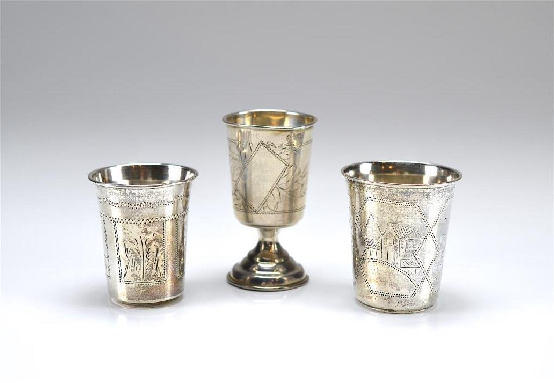Two Russian silver beakers and a footed vodka cup