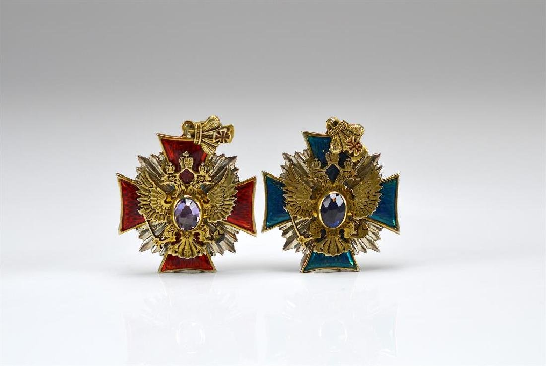 Two Russian silver and enamel badges