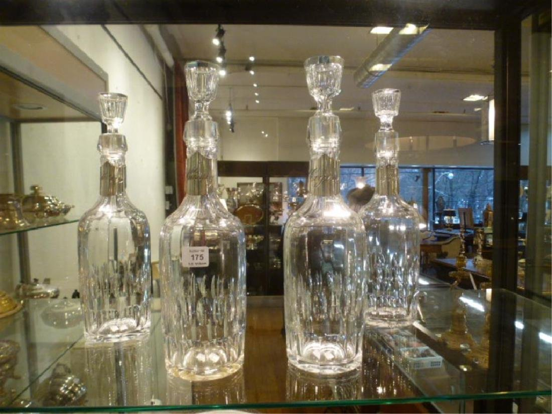 Set of four glass decanters