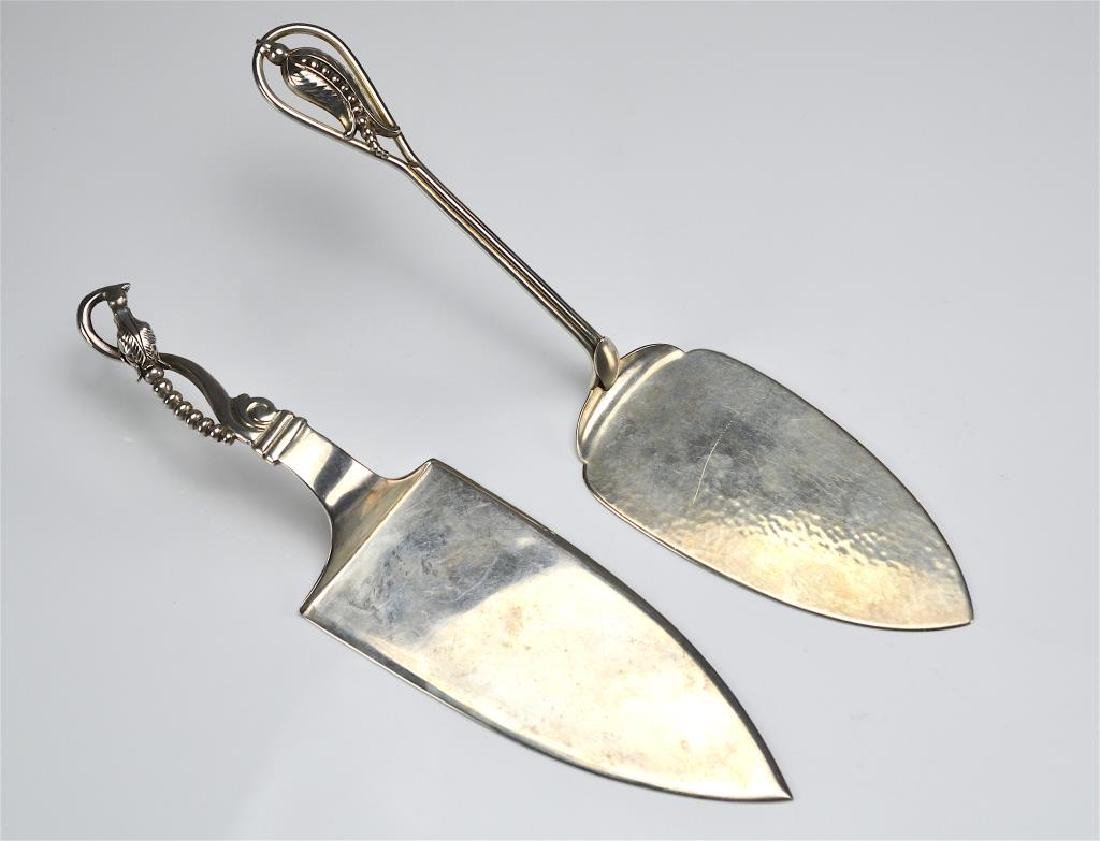 Two silver cake servers