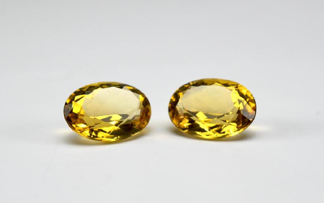 Two loose oval citrine gemstones