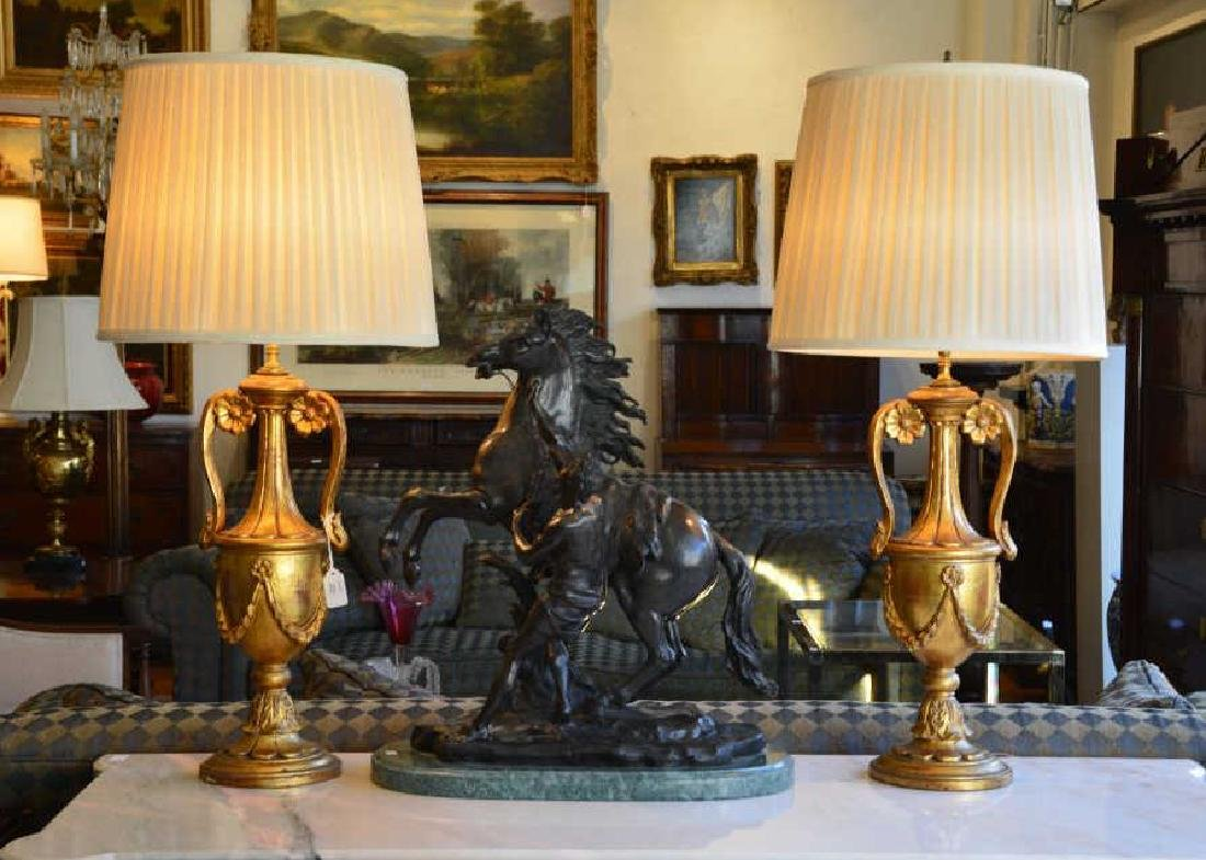 Pair of carved giltwood urn form table lamps
