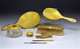 Nine piece English silver and enamel dresser set