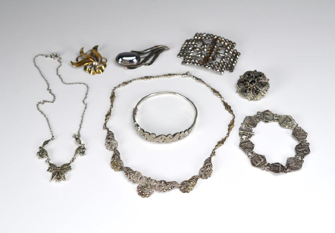 Lot of silver necklaces, brooches, and bracelets