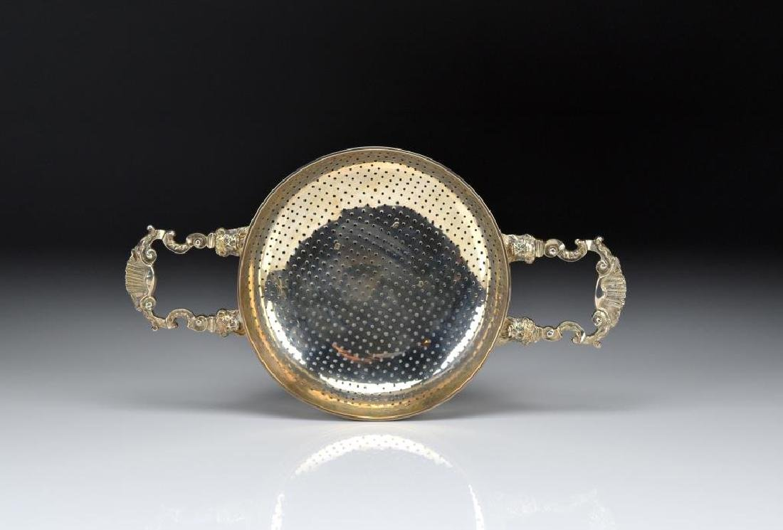 A LARGE GEORGE II SILVER PUNCH STRAINER