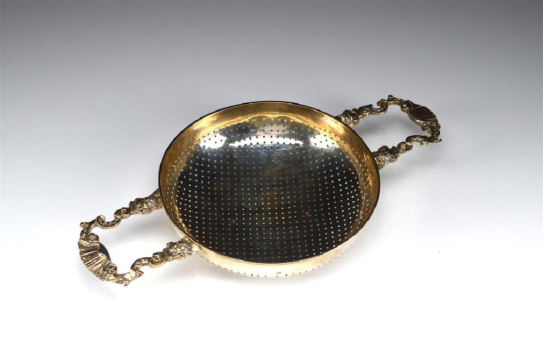 A LARGE GEORGE II SILVER PUNCH STRAINER - 2
