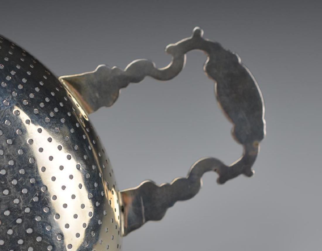 A LARGE GEORGE II SILVER PUNCH STRAINER - 8