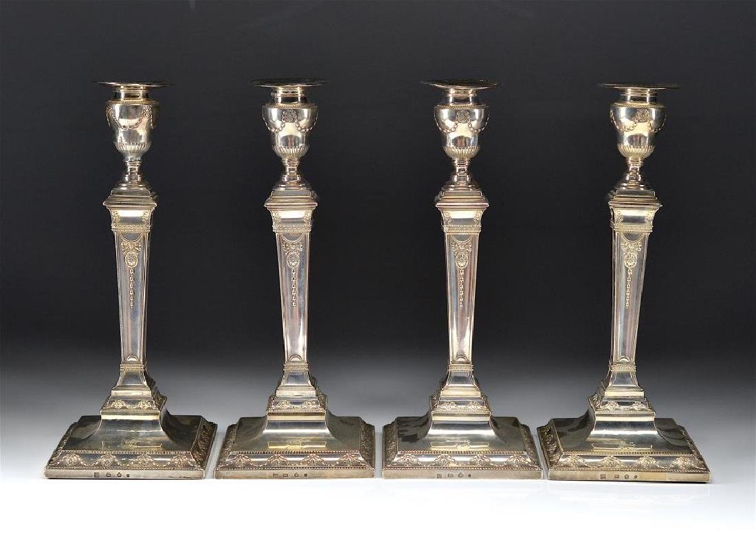 FOUR GEORGE III SILVER CANDLESTICKS