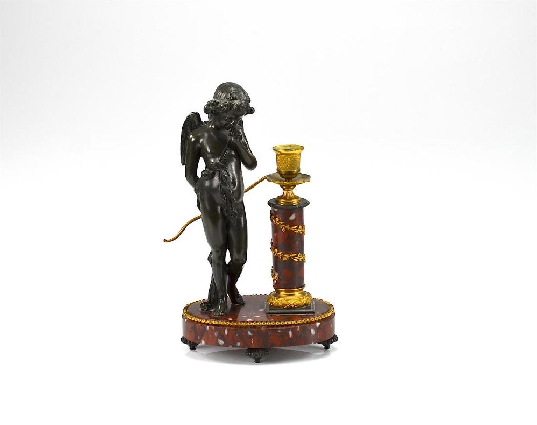 BRONZE AND MARBLE FIGURAL CANDLESTICK
