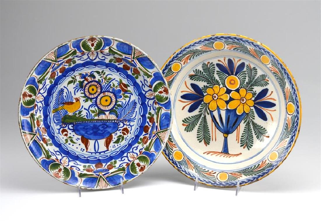 TWO DUTCH DELFT POTTERY FLORAL CHARGERS
