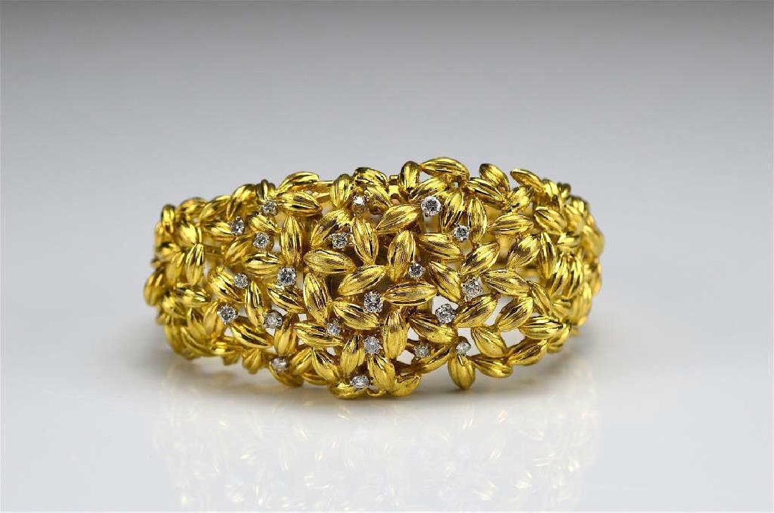 Lady's gold and diamond watch bracelet