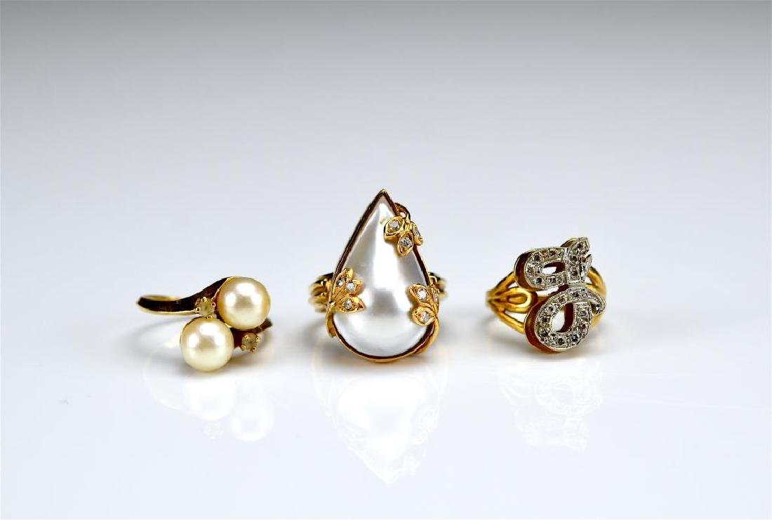 Three yellow gold rings