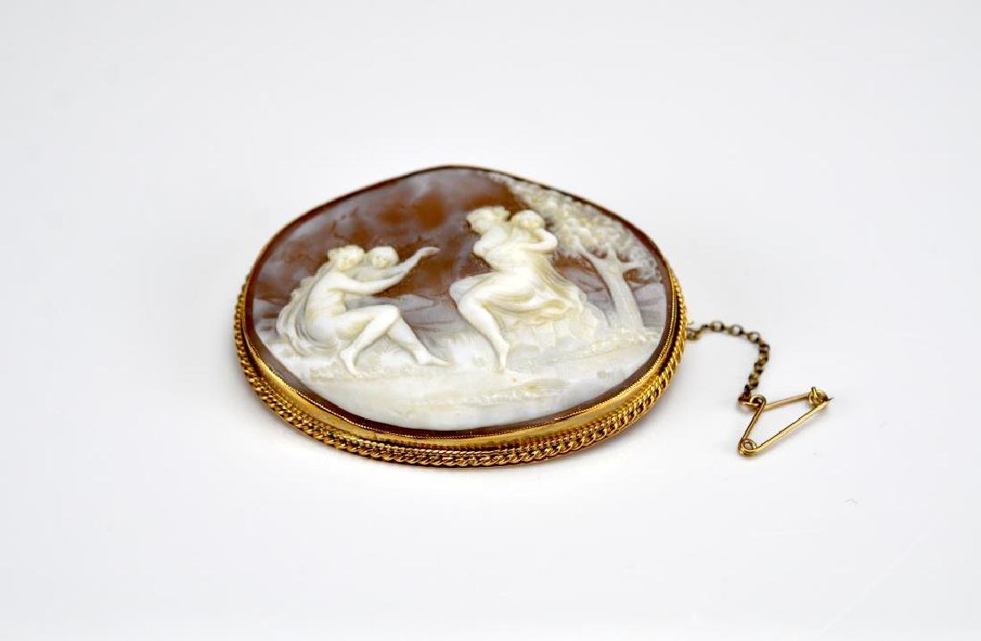 Antique gold framed cameo brooch