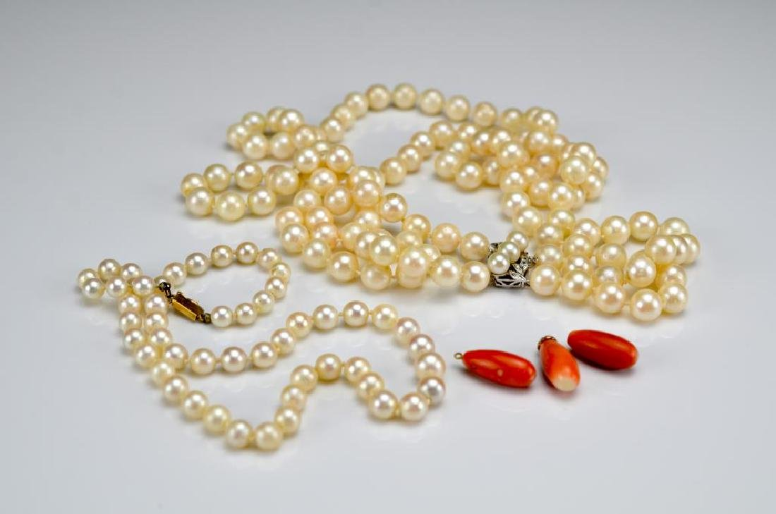 Two pearl necklaces and three coral beads