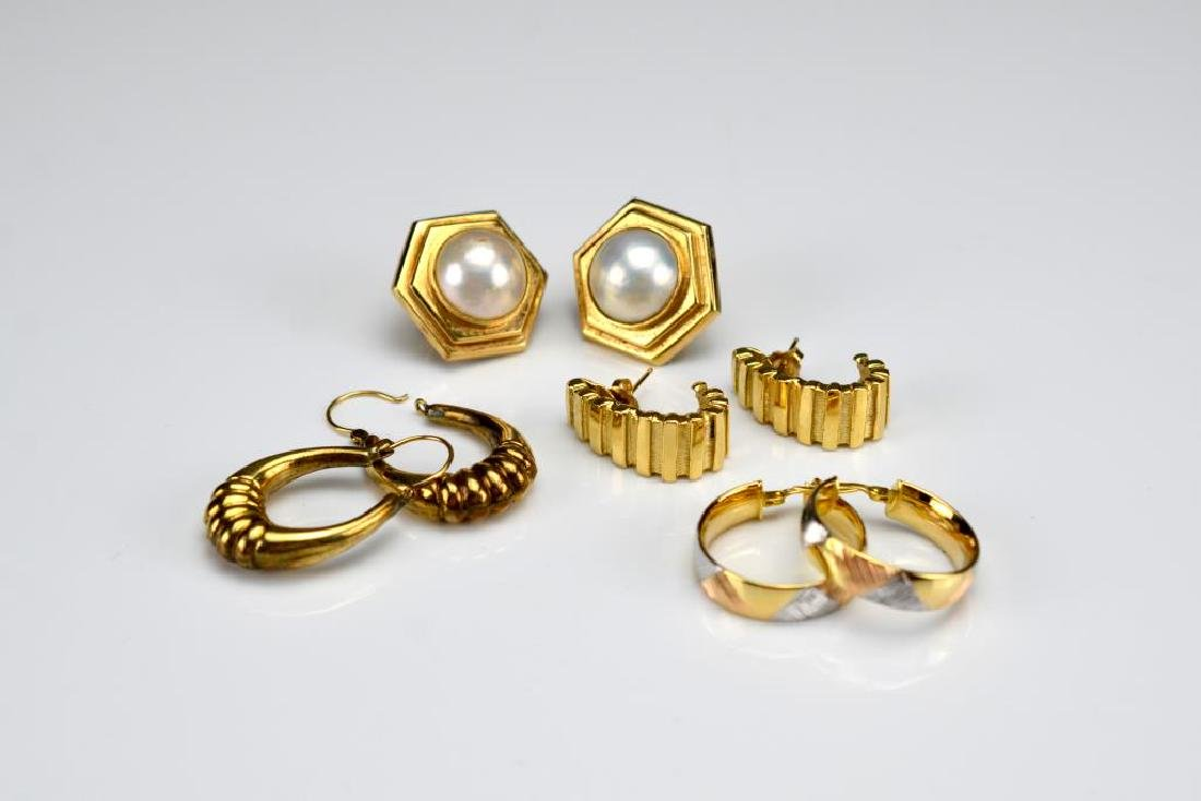 Four pairs of yellow gold earrings
