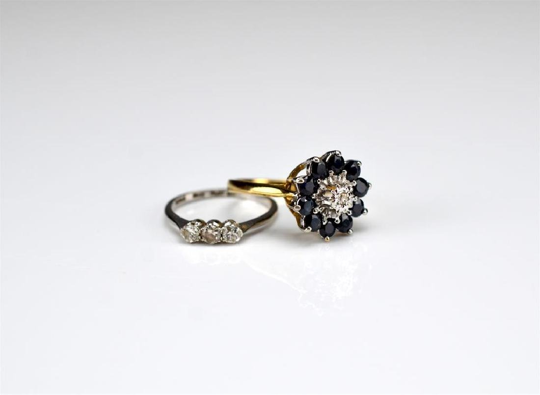 Two gold rings set with diamonds and sapphires