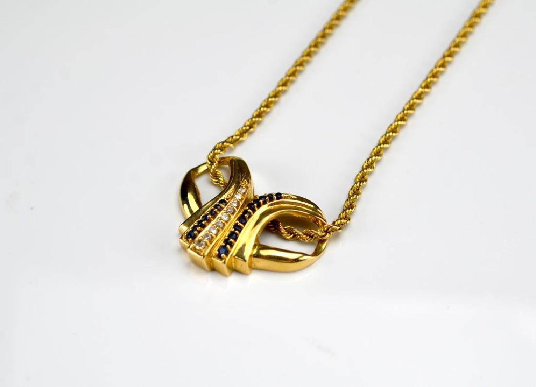 Gold pendant with diamonds & sapphires &gold chain