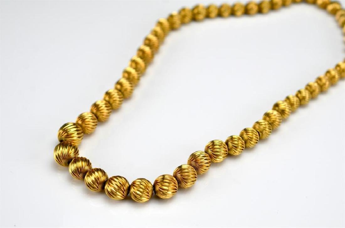 Graduated gold ball bead necklace