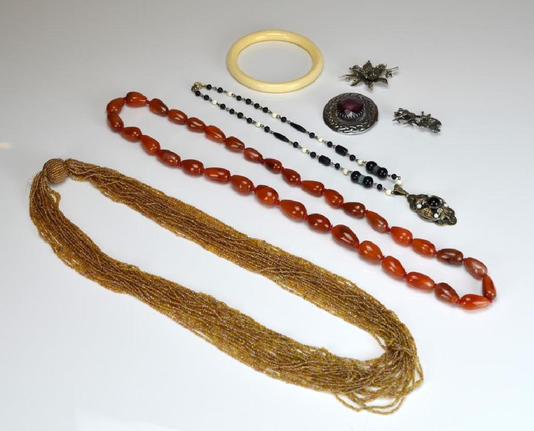 Lot of silver, beaded, and ivory jewellery